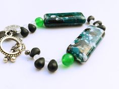 Check out this item in my Etsy shop https://www.etsy.com/listing/213633555/green-stone-bracelet