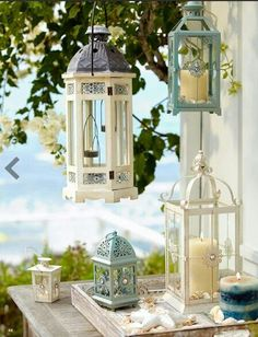 To Refresh Small Balconies i see these at goodwill all the time. I could spray paint them. hanging lights with candlesi see these at goodwill all the time. I could spray paint them. hanging lights with candles Lanterns Decor, Candle Lanterns, Garden Lanterns, Candleholders, Ikea Lanterns, Coastal Living, Coastal Decor, Ramadan Decoration, Balkon Design