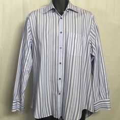 """Robert Talbott Carmel - Men's - Size M - Shirt Excellent condition. Looks like new - no stains, snags, or rips!  100% Cotton  Button Down  Long Sleeve  Blue / White / Purple Pattern  Regular Fit  Size M   Measurements (approx.) while item is lying flat on surface:  Chest (armpit to armpit): 22""""- You have to double this length to get chest circumference   Length (from the back of the neck to bottom): 28""""  Shoulder to shoulder: 19""""                              Sleeves (from top of shoulder to…"""