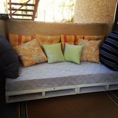 """Our Pallet Day Bed!  Super easy to make.  Take two palets, hold together with 3 1/2"""" X 4"""" bolts & nuts (don't forget your washers) and 5, 4"""" wheels, 3 that swivel and lock, 2 that are stationary, attach with appropriate sized bolts and nuts (again, don't forget your washers).  Cover with a twin mattress & pillows and enjoy!"""