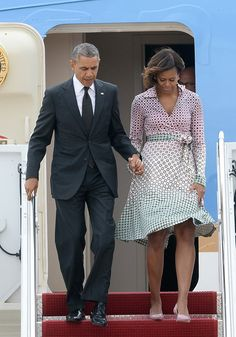 Pin for Later: 30 Summer Styling Secrets to Steal From Michelle Obama A Wrap Dress Never Goes Out of Style — or Season