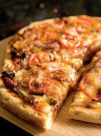 cheeseburger pizza - this is what we are having for dinner tonight. Well my homemade version of it at least.