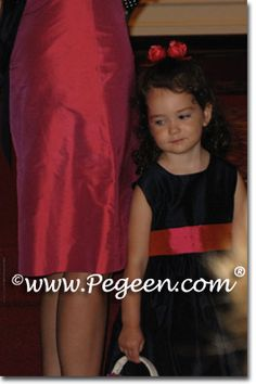 Navy and sorbet pink silk flower girl dresses available in over 200 colors from sizes infants through plus sizes.