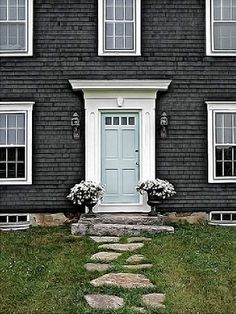 grey from the shingles and pale green door pictured above balance each other beautifully. For a similar door colour try Pale Powder #204 from Farrow & Ball