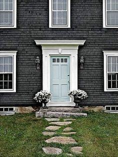 charcoal gray siding + blue door
