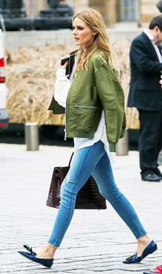 Olivia Palermo dressed up her bomber jacket by pairing it with tasseled loafers and a button down blouse