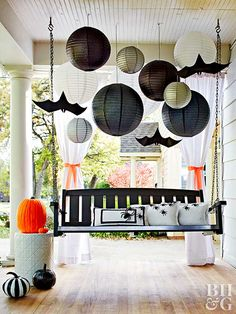Paper lanterns look ominous when paired with flying bat cutouts, painted pumpkins, and spider pillows.