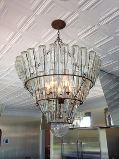 This is SO cool! The kitchen chandelier is made from upcycled bottles! #HouseofRock #SilestoneTrends