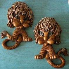 This is a pair of super cute and kitschy lions. Theyre a gold tone plastic. Manes and tails are scuffed for effect, some light scuffing to bodies. 12