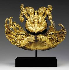 A Gilt Bronze Garuda Finial Tibet, Century The mythical bird expressively cast with large beak and paws, its curled wings outstretched with feathers rendered in elaborate foliate swirls, thickly cast from high copper content bronze and richly gilt Buddhist Symbols, Buddhist Art, Mythical Birds, Oriental, Wooden Statues, Tibetan Art, Ancient Artifacts, Culture, Asian Art