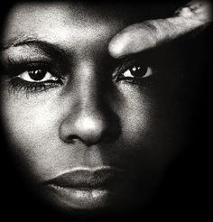 """Roberta Flack was on an airplane when she first heard the original version of """"Killing Me Softly With His Song"""" on the in-flight music program. She played it repeatedly, writing down the musical notes on scrap paper. Soon after, she went into Bob Marley's Tuff Gong studios in Jamaica and rehearsed the song but did not record it. In 1972, while opening for Marvin Gaye, she did an impromptu performance of it and the crowd went wild. She recorded it immediately. It spent 5 weeks at #1 in 1973."""