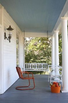 Both colors are standard Southern porch colors. The blue for the ceiling is traditional and functional since blue repels wasps, or so the lore goes. The gray floor is porch gray, which hides dirt and pollen in the spring.""