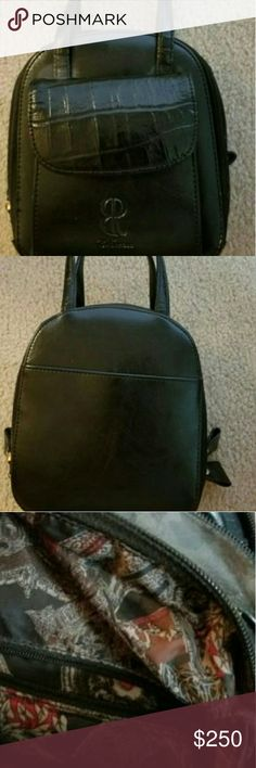 """Bill Blass Leather Handbag Black Tote Bag Bill Blass Black leather purse with beautiful cloth lining.  Many pockets and removable mirror. 7"""" x 6.5"""" x 3.5""""  please note that one of the four exterior zipper tabs is broken. I have left the tab in the purse if you should wish to have it repaired, the purse does functions fine without it. bill blass Bags Satchels"""