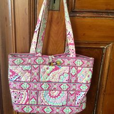 Vera Bradley Shoulder Bag This adorable bag offers organization in a stylish silhouette.  Two interior pockets keep the bags interior nice & neat.  Dimensions are 12'w x 12 1/2'h x 4'deep with an 11' strap drop. Vera Bradley Bags Shoulder Bags