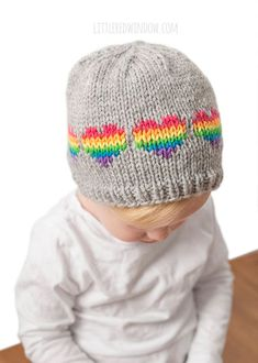 The Rainbow Heart Hat Knitting Pattern is one of my favorite knitting patterns o. The Rainbow Heart Hat Knitting Pattern is one of my favorite knitting patterns of all time. I just love the bright cheer. Boys Knitting Patterns Free, Baby Hat Knitting Pattern, Baby Hats Knitting, Valentine Hats, Knitted Hats Kids, Knit Hats, Diy Crafts Knitting, Rainbow Heart, Rainbow Baby