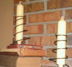 Picked up some rusty old bed springs & using them for candle holders.  Use old books for base and glue bottom of spring to book.