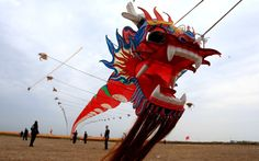 Contestants fly kites during the Rudong International Kite Festival in Rudong, China