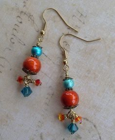 Color!  These earrings were designed to go with my Bumble Bee necklace from 1/9 FUF .. Orange and Blue Spectra Beads with the same color of Crystal that hang from bottom .. Jann Tague .. Clever Designs .. https://www.facebook.com/JewelsByJann