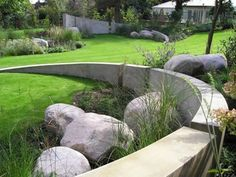 concrete wall and stones used as a sculptural element on large expanses.