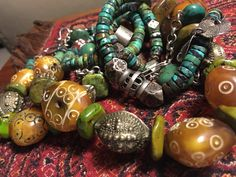 Agrab al fadda beads Mauritania with phenolic carved amber Mauritania with old silver and new Chinese turquoise.