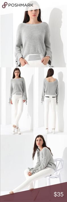 """Gray Crop Top So soft knit Crop Top with great grommet details on the sleeve.  Long bell sleeves.  XL measures 21"""" shoulder to hem and 24"""" armpit to armpit. More sizes to be listed shortly. Sweaters Crew & Scoop Necks"""