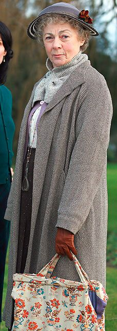 I love Miss Marple because she embraces her age with style and flair and tells us real women that it's ok to allow nature to take it's course.   Ladies, you can Botox till your ears disappear but I bet you'd love to just let go.....relax about the odd grey hair and the extra few pounds.