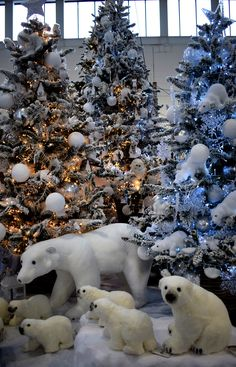 This family of polar bears is surrounded by a collection of frosted trees in a variety of styles, creating a wintery scene. Christmas Tree Inspiration, Christmas Tree Design, Cool Christmas Trees, Christmas Tree Themes, Xmas Tree, Christmas Holidays, Christmas Wreaths, Christmas Displays, Disney Christmas Decorations