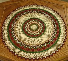 Riings Red Flowers with a Red, Green and White Graphic Design for this OOAK 21 Inch Table Topper - #Handmade #Crochet by @rssdesignsfriber of RSS Designs In Fiber - great for either a Nature Theme - or Holiday Theme!