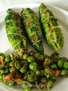 At first this combination of peas and karelas looks odd - but if you think about it , it's a perfect balance of flavors - some bitter , s. Indian Vegetarian Dishes, Kerala Food, Family Meals, Asparagus, Zucchini, Gourd, Vegetables, Bitter, Recipes