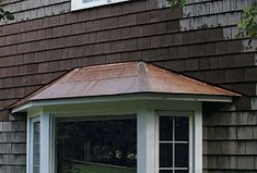 Copper Bay Roof Installation | flat-seam copper roof for a bay window