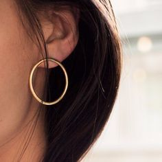 "Description Details Story With a clean and simple shape, the Duara Studs create an effortlessly classic look. As featured by Cup of Jo and Garance Dore. Soko jewelry is handcrafted by more than 1,300 artisans in Kenya. Join us in using design and innovation to change the fashion industry for good.Model photo courtesy Garance Dore Material: Brass Inner circle diameter: 1"" Style #: FW1500032/ FW1500032S As this product is handmade, each is one of a kind and may vary slightly. Brass is a ..."