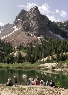 Hikers take a break at the top of  Lake Blanche with Sundial Peak behind in Big Cottonwood Canyon. (Tribune file photo)