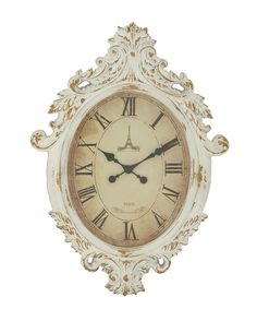 The Oval Shape Dial On Cream Color Frame Makes This Wall Clock Appear Radiant And Lively. The Exterior Of This Clock Is Wooden Carved So That It Achieves That Vintage Look. The Worn Out, Look Of This Wall Clock Add To Its Classic Appearance.
