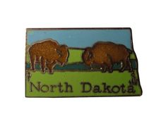 """vintage NORTH DAKOTA STATE lapel cloisonne enamel pin landscape Mafco buffalo by VintageTrafficUSA  14.00 USD  Add inspiration to your handbag tie jacket backpack hat or wall. 20 years old hard to find vintage high-quality cloisonne lapel/pin. Beautiful die struck metal pin with colored glass enamel filling. A vintage NORTH DAKOTA cloisonne pin by Mafco. Excellent condition. Measures: approx 1"""" Have some individuality = some flair! -------------------------------------------- SECOND ITEM…"""