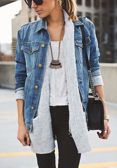 Try pairing a blue denim jacket with black slim jeans for a Sunday lunch with friends. Shop this look for $131: http://lookastic.com/women/looks/skinny-jeans-watch-crossbody-bag-cardigan-denim-jacket-tank-pendant-sunglasses/5747 — Black Skinny Jeans — Gold Watch — Black Leather Crossbody Bag — Grey Knit Cardigan — Blue Denim Jacket — Grey Tank — Gold Pendant — Black Sunglasses