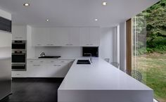 Pure white Ceasarstone countertop with mitered corners