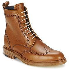 Terriblement british, cette paire de boots a bien entendu été imaginée par Barker, spécialiste de la classe à l'anglaise ! Avec son design fin et ses nombreux détails perforés à l'esprit romantique, elle nous fredonne une sérénade très mode, qui nous séduira à coup sûr ! - Couleur : Camel - Chaussures Homme 340,00 €
