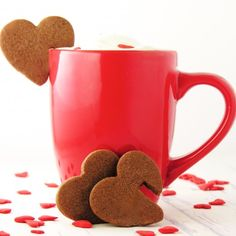 These adorable little cookies hang on the edge of a cup of coffee, cocoa or milk. Handy for dipping, and a perfect Valentine's Day treat!