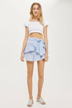 Add a super feminine flair to your summer style with this dobby ruffle tie mini skirt in blue. Pair with a plain tee for a casual-cool feel.