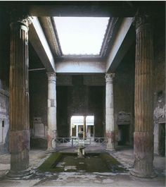 house of the silver wedding, pompeii: tetra style atrium columns, like the temple of hercules at cori: fluted above, stuccoed over and painted in red) - impluvium + compluvium (above) Mehr Ancient Pompeii, Pompeii And Herculaneum, Ancient Ruins, Ancient History, Roman Architecture, Sacred Architecture, Casa Azuma, Pompeii Italy, Rome Italy