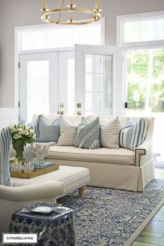 SUMMER LIVING ROOM TOUR WITH BLUE + WHITE : Bright and airy summer decorated living room featuring layered pillows with stripes and a light blue and white color palette for an elegant yet relaxed coastal theme. Coastal Living Rooms, Home Living Room, Living Room Designs, Living Room Furniture, Rustic Furniture, Cozy Living, Antique Furniture, Outdoor Furniture Sets, Outdoor Decor
