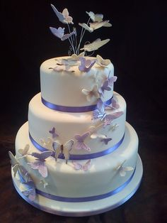 Butterfly Wedding Cake Lots of sugar butterflies airbrushed for a nice effect cover this cake in a swave. Round Wedding Cakes, Elegant Wedding Cakes, Beautiful Wedding Cakes, Beautiful Cakes, Wedding Cake Decorations, Wedding Cake Designs, Wedding Cake Toppers, Wedding Ideas, Butterfly Wedding Cake