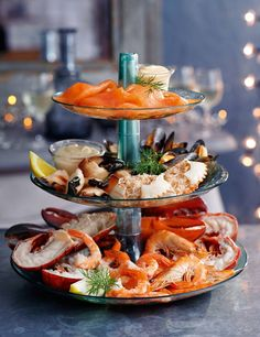 Serve mixed cold seafood on a cake stand as an elegant starter. Serve dips and sides in separate dishes so that guests are not waiting for one single platter to be passed around.