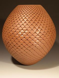"""Chocolate Pinecone"" Ceramic Vase  Created by Michael Wisner  A handbuilt and incised ceramic vessel crafted from Colorado clays."