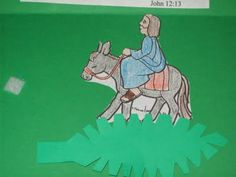 Palm Sunday craft idea.  Place a brad on the palm leaf, so kids can move it to place under donkey and Jesus.