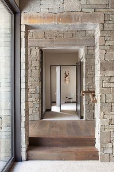 Locati Architects creates cotemporary Rocky Mountain Retreat in the ranges of Montana Stone Tile Flooring, Stone Backsplash, Rocky Mountains, Open Kitchen Layouts, Montana, Wooden Staircases, Wooden Ceilings, Open Layout, Staircase Design
