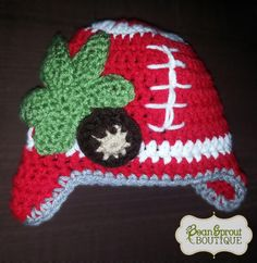 Show your team spirit with this crochet football earflap hat in OSU colors with buckeye. Great as a photography prop for newborns, or for a child.   BeanSproutBoutique.com