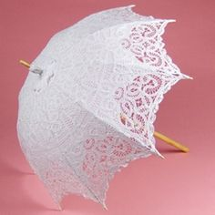 This beautiful walking length white parasol is a lightweight, elegant sunshade made from Battenburg Lace.