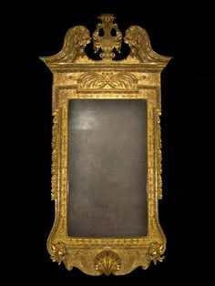 Important George II mirror in the manner of William Kent (architect and designer for Royalty in the first half of the 18th century).