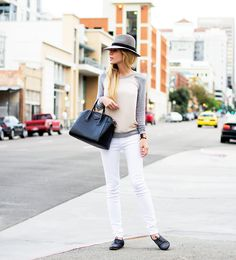 White pants / derbies / grey and beige sweater / hat
